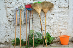 Old brooms,brushes,mops and pails Royalty Free Stock Images