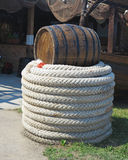 Old brown barrel and white rope near fishing nets Stock Photography