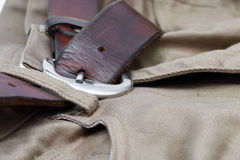 Old brown belt with jeans Stock Images