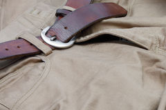 Old brown belt with jeans Royalty Free Stock Photos