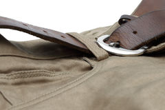 Old brown belt with jeans Royalty Free Stock Images