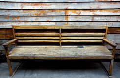 Old brown bench with old wall Royalty Free Stock Photography