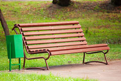 Old brown bench in park Stock Photos
