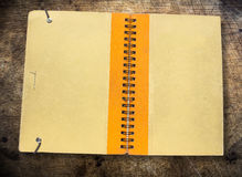 Old brown book cover. Old book on brown wooden background. Illustrate the general Stock Images