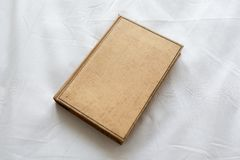 Old brown book hardcover. Closed old brown book hardcover Stock Image