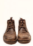 Old brown boots isolated Stock Photo