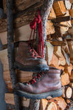 Old brown boots on woodpile background Royalty Free Stock Image