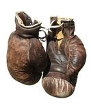 Old brown boxing gloves . Stock Photography