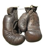 Old brown boxing gloves . Stock Photos