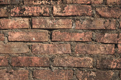 Old brown brick wall background Stock Photos