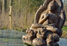 Old brown Buddha statue Royalty Free Stock Images