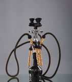 An old brown ceramic hookah on a grey background Royalty Free Stock Images