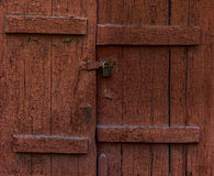 Old brown closed shutters. With cracked paint close-up shot Royalty Free Stock Photo