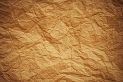 Old brown crumpled paper textured background Stock Photos