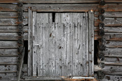Old brown and dirty barn door Stock Photos