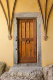 Old Brown Door. A photo of an old door with stone steps leading to it Royalty Free Stock Photography