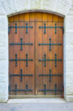 Old Brown Door. A photo of an old door with stone steps leading to it Royalty Free Stock Image