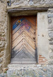 Old brown door of a medieval house Royalty Free Stock Images