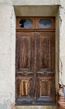 Old brown door of a morbid house Stock Photos