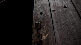 Old brown door. Old wooden door opens.