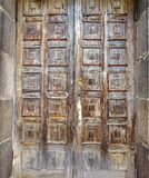 Old brown door with squares royalty free stock photos