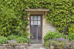 Old brown doors in an  english stone house Royalty Free Stock Photography