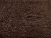 Old brown fabric leather look. Old worn dark brown fabric. Leather look texture (cover of an old book Stock Photo
