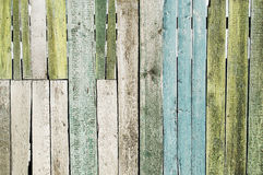 Old brown fence. Texture of old wooden fence painted in green Stock Photos