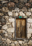 Old brown folding shutter. Medieval house with morbid folding shutters Stock Image