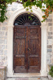 Old brown front door. The picture was taken in Rose Stock Image