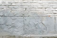 Old brown and gray cobblestone. Wall texture Stock Images