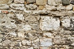Old brown and gray cobblestone. Wall texture Stock Image