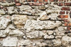 Old brown and gray cobblestone. Wall texture Royalty Free Stock Photo