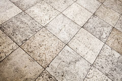 Old brown gray stone floor tiling texture Stock Photography