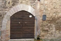 Old, brown Italian front door Royalty Free Stock Photography