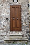 Old, brown Italian front door Stock Photo
