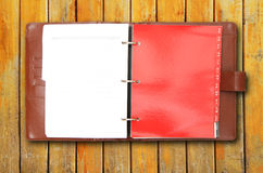 Old brown leather cover notebook Stock Photo