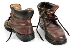 Old brown leather work boots. Isolated on white Stock Photography