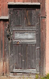 Old brown locked wooden door Stock Photography