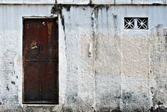 Old Brown Metal Door on a White Gate Stock Images