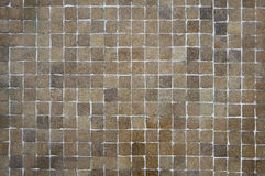 Old brown mosaic wall background texture Royalty Free Stock Image