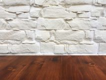 Old brown oak wooden table on the blurry white wash wall background, wood table stock image