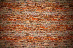 Old brown, orange, grunge red brick wall for texture, background. Old dark brown brick fences, orange brick wall or grungy rusty blocks of stone work for texture stock images