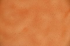 Old brown orange leather background texture. Old brown orange color natural genuine leather grain background texture close up stock photos