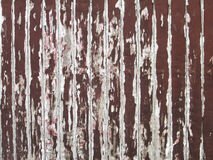 Old brown paint coming off wooden boards Stock Image