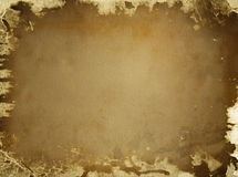 Old  brown paper background. Old torn brown paper background covered with black spots Royalty Free Stock Image