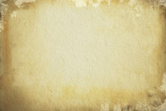 Old  brown paper background. Old torn brown paper background covered with black spots Stock Photography