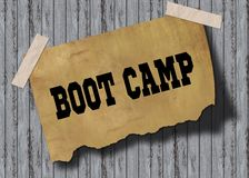 Old brown paper with BOOT CAMP text on wooden background. Illustration Stock Photography