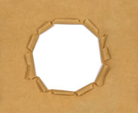 Old brown paper with hole Royalty Free Stock Photo