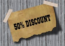 Old brown paper with 50 PERCENT DISCOUNT text on wooden background. Illustration Royalty Free Stock Photography